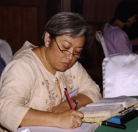 Tess Cusi, the Philippines, studies the book of Mark at the Thailand renewal in August, 2003.
